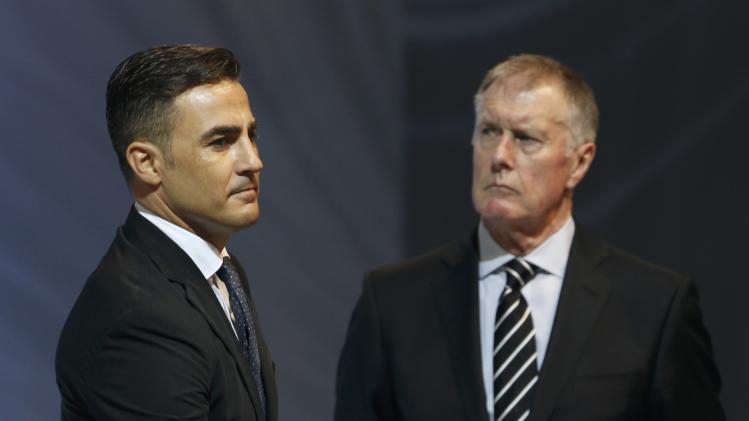 Cannavaro draws a ball as former Hurst looks on, during the draw for the 2014 World Cup in Sao Joao da Mata