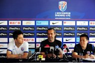 Sergio Batista (centre), head coach of Chinese Super League side Shanghai Shenhua, attends a press conference in Shanghai on June 21, a day after signing former Chelsea player Didier Drogba. Chelsea star Drogba's signing is sweetly timed as China looks to turn the page on its legendary corruption -- but it's also sparked heated debate over a new wave of foreign players