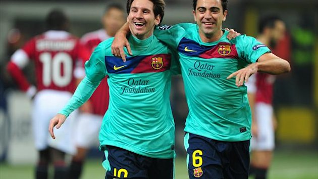 Lionel Messi, left, Xavi, right, and Carles Puyol have agreed new contracts at Barcelona