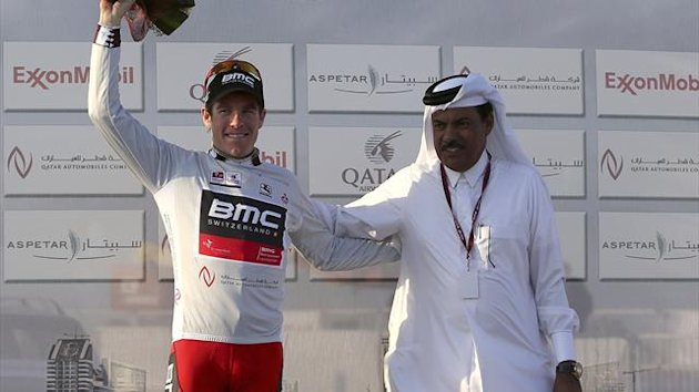 BMC Racing's Brent Bookwalter of the U.S. (L) celebrates on the podium