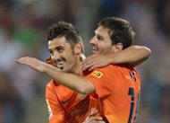 Barcelona's Lionel Messi (L) and David Villa celebrate after scoring during their Spanish La Liga match vs Getafe at the Alfonso Perez stadium in Getafe, near Madrid, on September 15. With Messi leading the way, Barca have made a storming start with four straight wins in the league and now play Granada at the Camp Nou, on Saturday