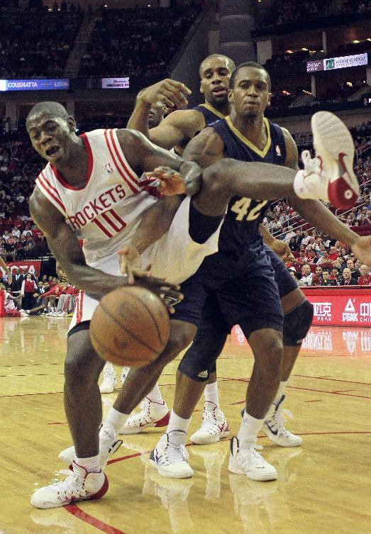 Houston Rockets forward Ronnie Brewer loses the ball under the basket as he is defended by New Orleans Pelicans forward Lance Thomas during the second half of a preseason NBA basketball game in Houston, Saturday, Oct. 5, 2013. The Pelicans won the game 116-115