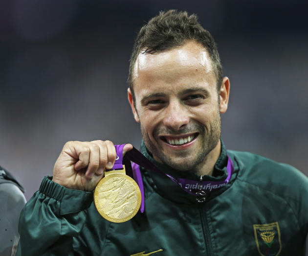 South Africa's Pistorius celebrates with gold medal after winning men's 400m T44 classification at Olympic Stadium during the London 2012 Paralympic Games