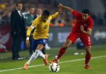 Ismail Koybasi of Turkey (R) challenges Neymar of Brazil (L) during their international friendly soccer match at Sukru Saracoglu stadium in Istanbul November 12, 2014.  REUTERS/Murad Sezer (TURKEY  - Tags: SOCCER SPORT)