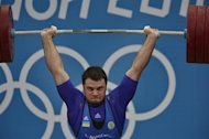 Ukrania's Oleksiy Torokhtiy competes to win the gold medal during the men's 105kg group A weightlifting event of the London 2012 Olympic Games at The Excel Centre in London on August 6, 2012. AFP PHOTO / YURI CORTEZ