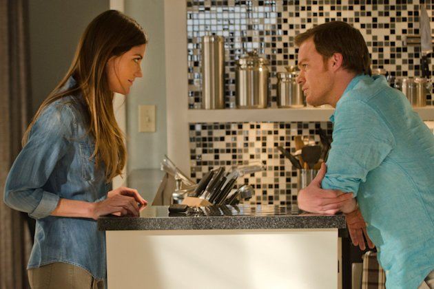 Jennifer Carpenter as Debra Morgan and Michael C. Hall as Dexter Morgan in the 'Dexter' Season 8 episode, 'Dress Code.'