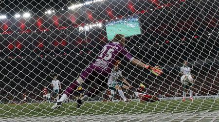 William Yarbrough of Mexico's Leon falls to save a goal by Alecsandro of Brazil's Flamengo during their Copa Libertadores soccer match in Rio de Janeiro