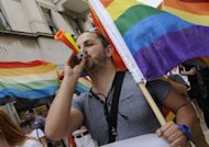 A demonstrator blows a horn as he takes part to the Gay Pride parade in the Adriatic port of Split. Hundreds of riot police were on guard Saturday as Croatia's second city hosted a gay parade seen as a test of tolerance in the EU-bound country after violence last year left a dozen people injured