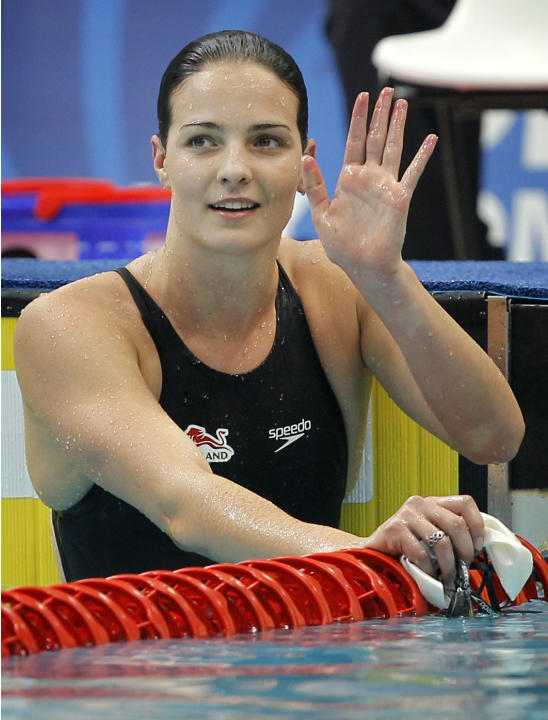 ** CORRECTS DATE ** England's Keri-Anne Payne waves after clocking the fastest time in the 400 m individual medley during the Commonwealth Games at the Dr. S.P. Mukherjee Aquatics Center in New De
