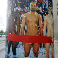"TO GO WITH STORY BY GEORGE JAHN - AUSTRIA NAKED MEN - In this picture taken Oct. 18, 2012 a poster with naked men is on display in Vienna, Austria, Thursday, Oct. 18, 2012 Poster reads: Naked Men. It's raining men - naked men of all sizes and shapes- as a prestigious Vienna museum kicks off a show of male nudity. But outside the exhibition, organizers are being forced into cover-up mode after a storm of complaints that posters splashed across the city advertising the art are offensive. Entitled ""Naked Men from 1800 to Today,"" the Leopold Museum opened its doors Friday Oct 19, 2012 to a display showing how artists dealt with the theme of male nudity over more than two centuries. (AP Photo/Ronald Zak)"