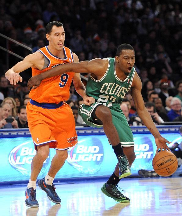 Boston Celtics' Jordan Crawford (27) drives the ball past New York Knicks' Pablo Prigioni (9) during the second half an NBA basketball game on Sunday, Dec. 8, 2013, in New York. The Celtics won 114-73