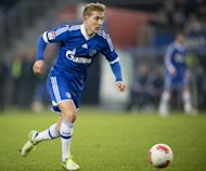 This picture taken on November 27, 2012 shows Schalke's Lewis Holtby in action against Hamburg. Tottenham Hotspur-bound Holtby will quit the Bundesliga to fulfil his dream of playing in England, but the midfielder insists the move will not harm his Germany prospects