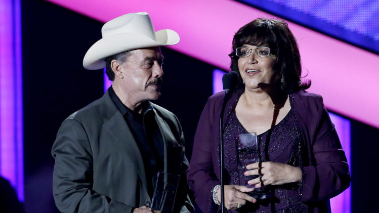 The parents of Jenni Rivera, Pedro Rivera, left, and Rosa Saavedra accept six awards at the Latin Billboard Awards in Coral Gables, Fla., Thursday April 25, 2013.  Jenni Rivera died in a plane crash last year. (AP Photo/Alan Diaz)