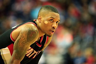 Damian Lillard's sticking around Rip City for the next few years. (Rob Carr/Getty Images)
