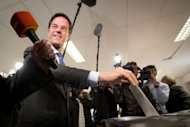 Dutch Prime Minister and leader of the conservative Liberal VVD party Mark Rutte casts his ballot on September 12, 2012 at a polling station in the Hague for the country's general election. The Netherlands voted in crunch polls Wednesday seen as a barometer of anti-European sentiment after a riveting campaign that has shaped into a tight race between two pro-Europe parties