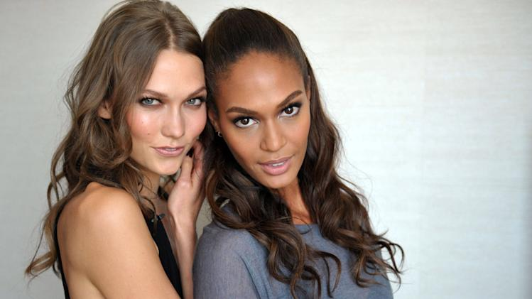 "Models Karlie Kloss and Joan Smalls pose for a photograph on Sept. 4, 2012 in Los Angeles, Calif.  The ""House of Style"" that MTV built back in 1989 has undergone some serious renovation, but it always had good bones. The show's past and present come together in a documentary called ""House of Style: Music, Models, and MTV"" that makes its televised premiere on Saturday.(Photo by John Shearer/Invision for MTV.com/AP Photo)"