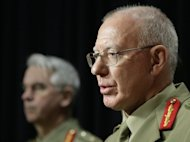 This file photo shows General David Hurley (R) briefing the media in Canberra, on June 8, 2010. Australia and China are planning joint military exercises which may also include the United States as the nations work to ensure stability in the region, Hurley said in an interview with an Australian paper, published on Wednesday