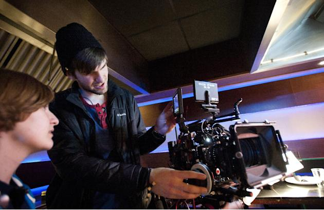 "ADVANCE FOR SUNDAY APRIL 27 AND THEREAFTER - Tyler Penrod works on the camera while filming ""Altar Ego"" as the second assistant camera operator with the Liberty University Cinematic Arts pro"