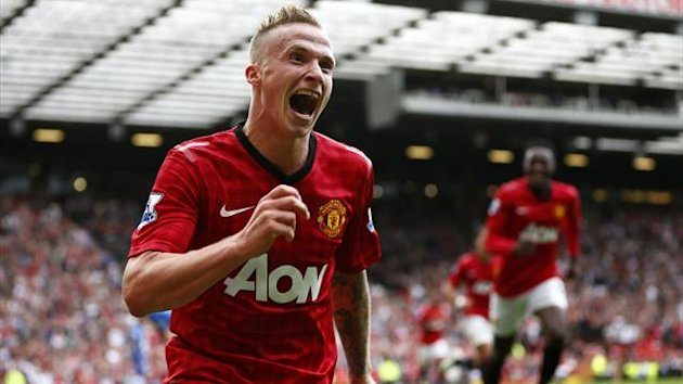 Manchester United's Alexander Buttner celebrates his goal against Wigan Athletic during their English Premier League soccer match at Old Trafford in Manchester, northern England, September 15, 2012 (Reuters)