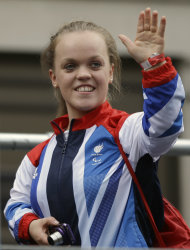 Britain's swimmer Ellie Simmonds waves to the crowds as the Team GB Olympic and Paralympic teams parade in the streets of London, Monday, Sept. 10, 2012. Our Greatest Team Parade, the procession of athletes, celebrates the achievements of British Olympians and Paralympians at the London 2012 Games. (AP Photo/Lefteris Pitarakis)