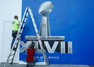 Workers put the finishing touches to a Super Bowl sign on January 29, 2013 in New Orleans. This Sunday, nearly 180 million Americans will settle in front of TV sets to watch the Super Bowl. For advertisers, it's a showcase like no other.