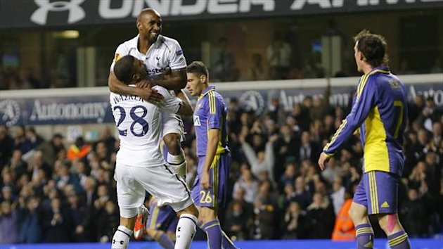 Jermain Defoe celebrates his hat trick with Tottenham team-mate Kyle Walker (Reuters)
