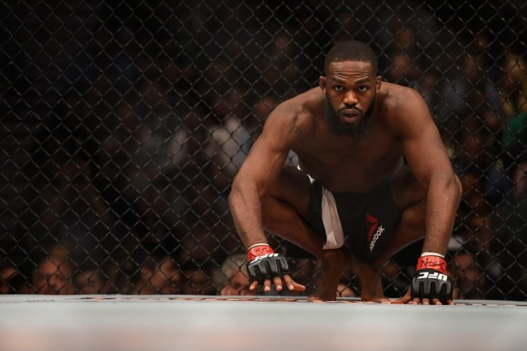 Jon Jones crouches in his corner before facing Ovince Saint Preux in their interim UFC light heavyweight championship bout during the UFC 197 event in...