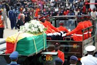 File picture. A military cortege conveys the body of late Ghana president John Atta Mills on August 10, 2012 in Accra. Mills died in July.