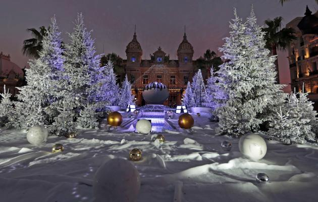 Christmas trees frame the Monte Carlo Casino as part of holiday season decorations in Monaco