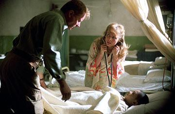 Stellan Skarsgard , Izabella Scorupco and Remy Sweeney in Warner Brothers' Exorcist: The Beginning