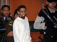 Indonesian Muslim militant and suspected Bali bomber Umar Patek (C), seen as he enters a court room in Jakarta, on February 20. Patek's stay in the same Pakistani town where Osama bin Laden was later killed in a US raid was a coincidence and the pair never met, according to his lawyer