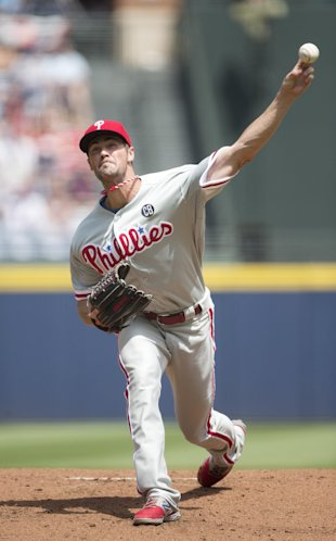 Cole Hamels was part of a no-hitter on Monday in Atlanta. (AP)