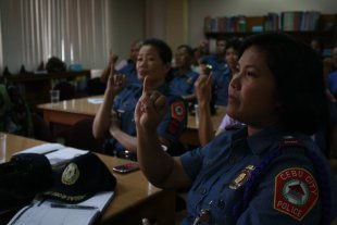Cebu City police personnel learn sign language to help Deaf victims of sexual abuse.