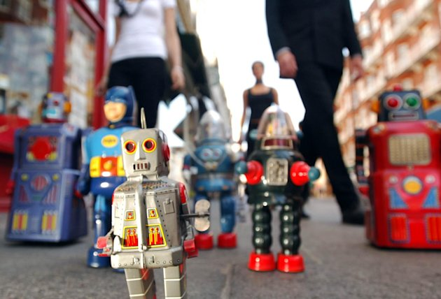 A selection of the Paul Lips Collection of robots and other space toys invade the pavement of South Kensington outside Christie's auction house in London Thursday September 8, 2005. Image Andrew Stuart/PA