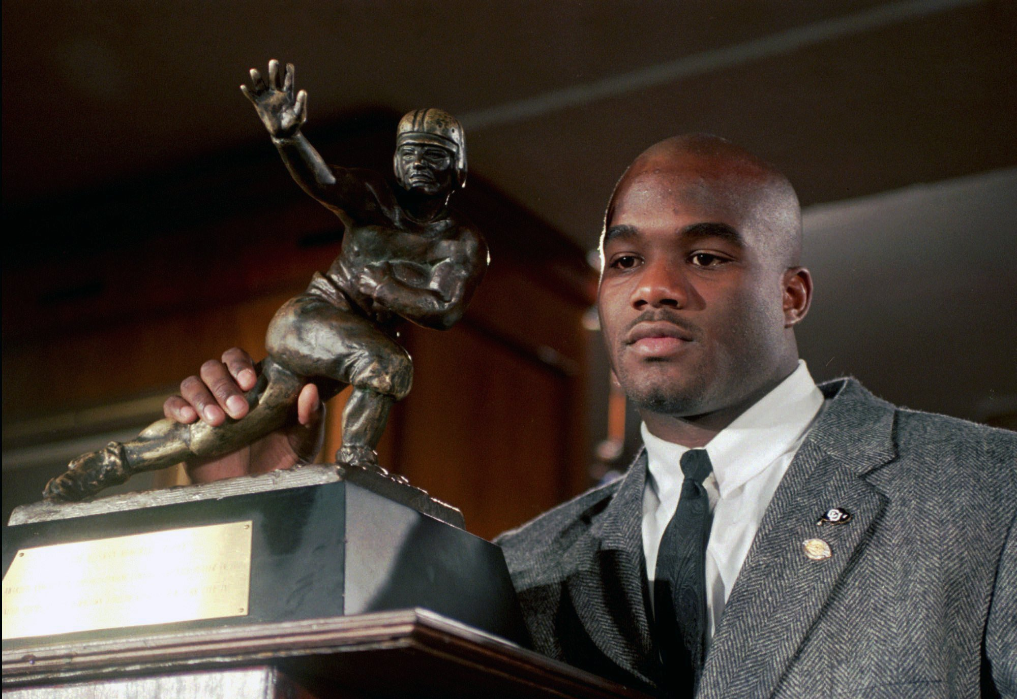Rashaan Salaam poses with the Heisman Trophy after winning it on Dec. 19, 1994. (AP)