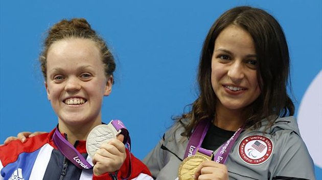 Britain's Eleanor Simmonds (L) holds the silver medal and Victoria Arlen of the U.S. holds the gold medal that they received for the women's 100m freestyle - S6 final in the Aquatics Centre at the London 2012 Paralympic Games (Reuters)
