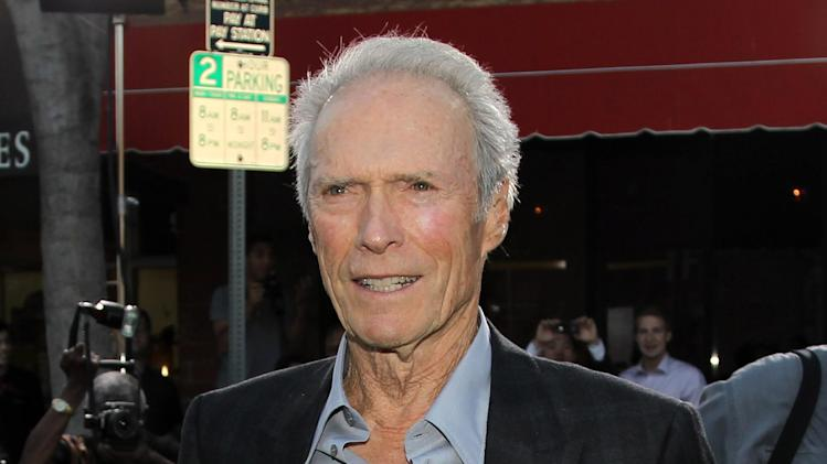 "FILE - This Sept. 19, 2012 file photo shows actor-director Clint Eastwood at the premiere of ""Trouble With the Curve"" at the Westwood Village Theater in Los Angeles. In a wide-ranging interview Saturday about film directing at the Tribeca Film Festival, Eastwood said he admires the 104-year-old Portuguese director Manoel de Oliveira.  Said Eastwood: ""It would be great to be 105 and still making films."" He laughed and called such a hope ""the ultimate optimism.""  The director joined fellow filmmaker Darren Aronofsky for a staged conversation at the New York film festival following a screening of Richard Schickel's documentary: ""Eastwood Directs: The Untold Story.""  (Photo by Matt Sayles/Invision/AP, file)"