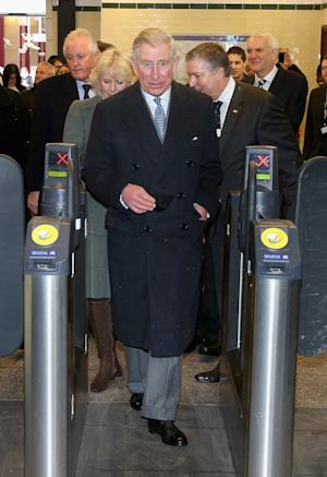 Britain's Prince Charles, and Camilla, Duchess of Cornwall, walk through a ticket barrier as they prepare to travel on a London underground train as they mark 150 years of London Underground, Wednesday Jan. 30, 2013.  (AP Photo/Chris Jackson, Pool)