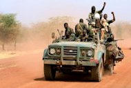 "Sudanese soldiers ride in a military vehicle in the oil region of Heglig in April 2012. South Sudan has not stopped hostilities in line with a UN resolution because it continues to ""occupy"" points along the disputed border and will be expelled by force, Sudanese officials said Friday"