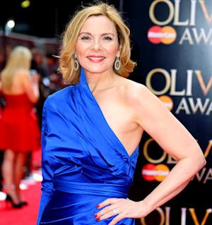 "Kim Cattrall Says ""Fizzy Yoga"" Saved Her Life"