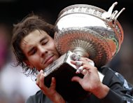 Spain's Rafael Nadal celebrates with his trophy after winning against Serbia's Novak Djokovic their Men's Singles final tennis match during the French Open tennis tournament at the Roland Garros stadium, on June 11, 2012 in Paris. AFP PHOTO / FRANCOIS GUILLOTFRANCOIS GUILLOT/AFP/GettyImages