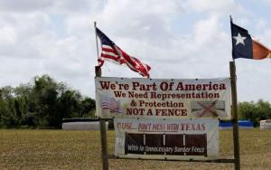 A sign sits on display in a farm field near the U.S.-Mexico border outside Brownsville, Texas