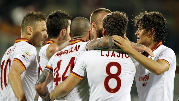 Roma players celebrate Radja Nainggolan's goal during a Serie A soccer match between Fiorentina and Roma at the Artemio Franchi stadium in Florence, Italy, Saturday, April 19  2014