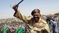 "Sudanese President Omar al-Bashir waves to the crowd during his visit to the Northern Kordofan town of El-Obeid to address a rally of freshly-trained paramilitary troops. Bashir vowed on April 19, to teach ""a lesson by force"" to the South Sudanese government over its seizure of the north's main Heglig oil field"