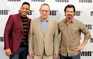 "L-R: Actors Will Smith, Tommy Lee Jones and Josh Brolin pose at a photo call for Columbia Pictures' ""Men In Black 3"" on May 3, in Los Angeles, California. The third edition of the ""Men In Black"" franchise blasted its way to the top of North America's weekend box office, ending the three-week hold of the record-breaking ""Avengers,"" figures showed Tuesday"