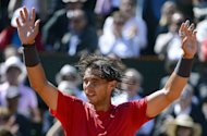 Spain's Rafael Nadal celebrates after wining French Open semi-final against countryman David Ferre on June 8. Nadal insisted he feels 'zero' pressure going into the history-defining French Open final against Novak Djokovic even if heavy rain threatens to swamp the Roland Garros spectacle