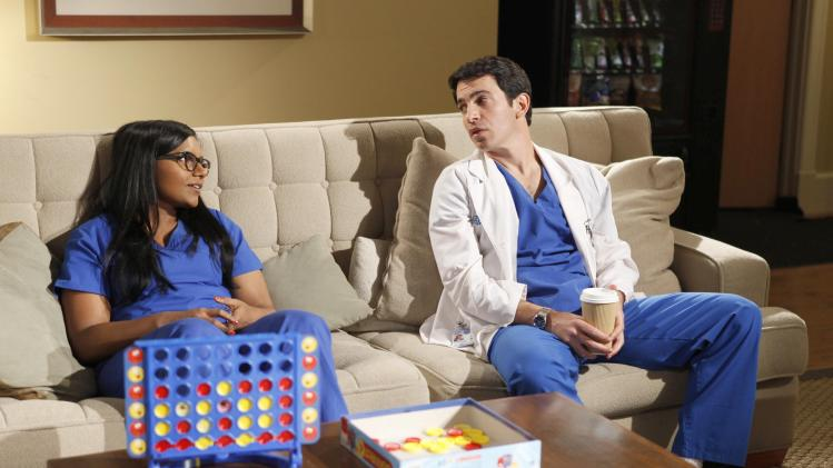 "This image released by Fox shows Mindy Kaling, left, and Chris Messina in a scene from ""The Mindy Project,"" premiering Sept. 25 at 9:30 p.m. on Fox. (AP Photo/Fox, Beth Dubber)"