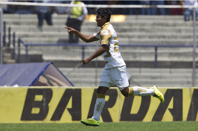 Pumas' Daniel Ramirez celebrates after scoring against Chivas during a Mexican soccer league match in Mexico City, Sunday, April 20, 2014