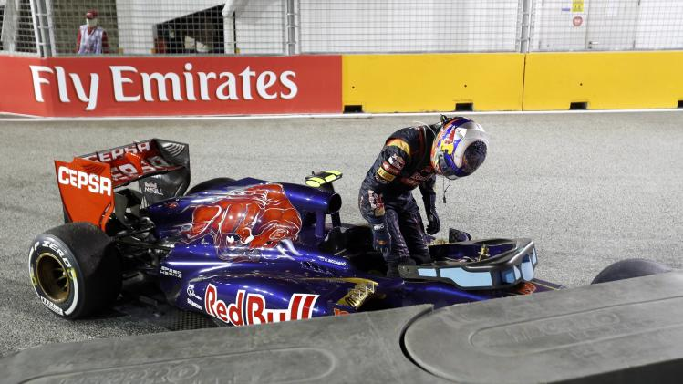 Toro Rosso Formula One driver Ricciardo gets out of his car after crashing during the Singapore F1 Grand Prix in Singapore