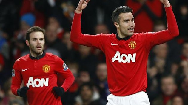 2014Manchester United's Juan Mata (L) looks on as teammate Robin van Persie celebrates scoring against Cardiff